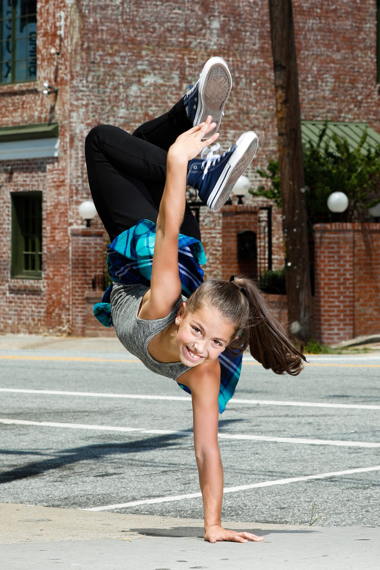 Tween and teen gymnastics pictures taken to celebrate the milestones of you child. Photographed in Atlanta and surrounding suburbs by Starr Petronella and Urban Flair Photography.