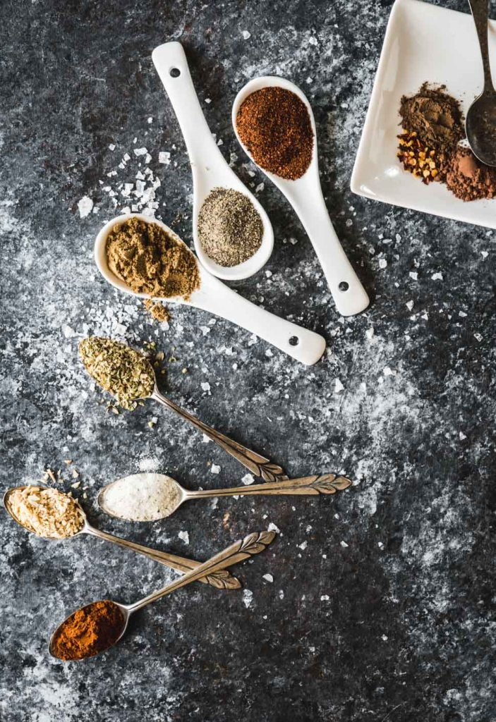 Taco seasoning spices on small spoons