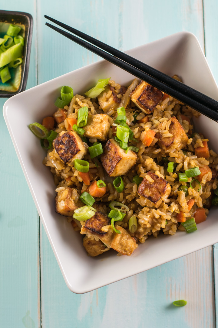 Fried rice topped with carrots, tofu and green onions