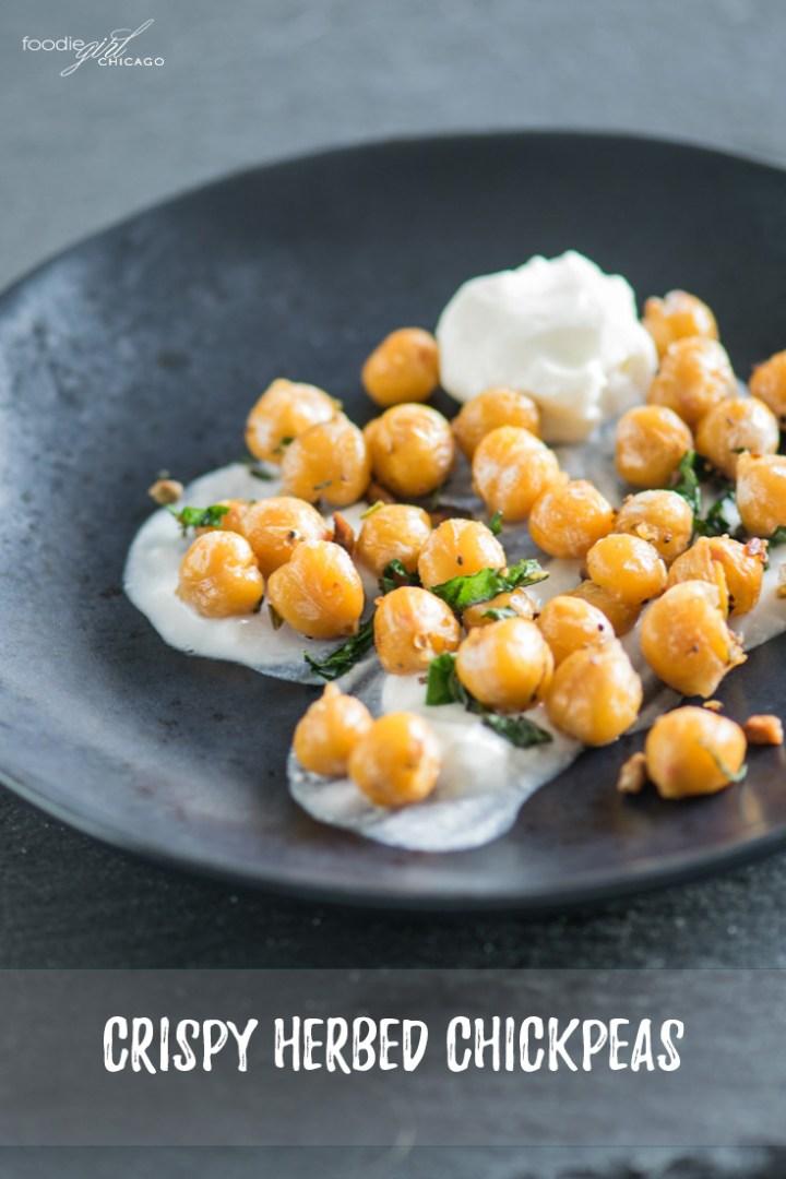 Crispy herbed chickpeas with greek yogurt on a black plate