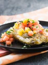 This grilled sea bass is topped with a light, refreshing watermelon mango salsa