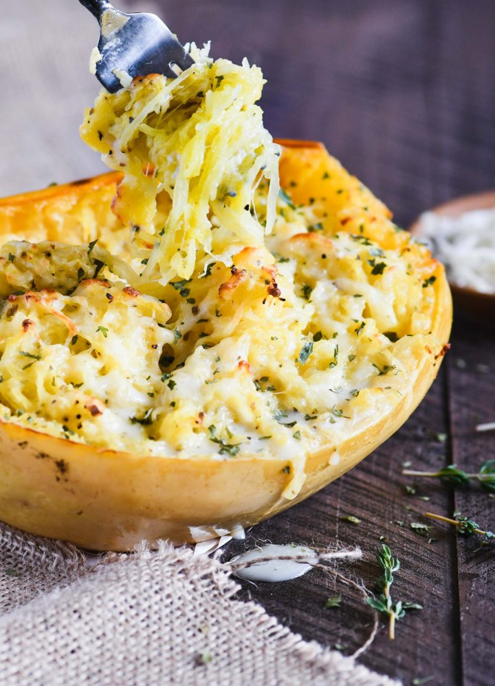 Cheesy Garlic Spaghetti Squash swirled up on a fork.