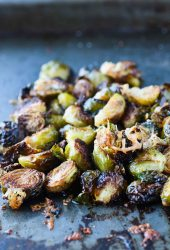 These crispy roasted brusselssprouts topped with parmesan and pomegranate simple syrup will give new meaning to the words side dish!