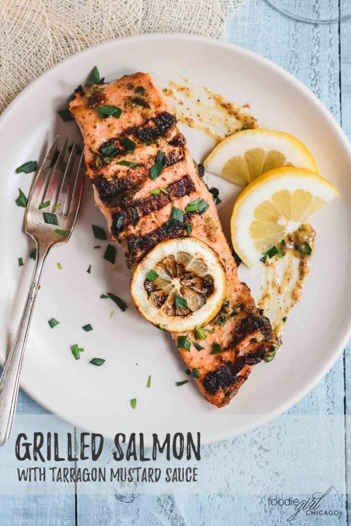 Grilled salmon filet with mustard sauce and tarragon leaves