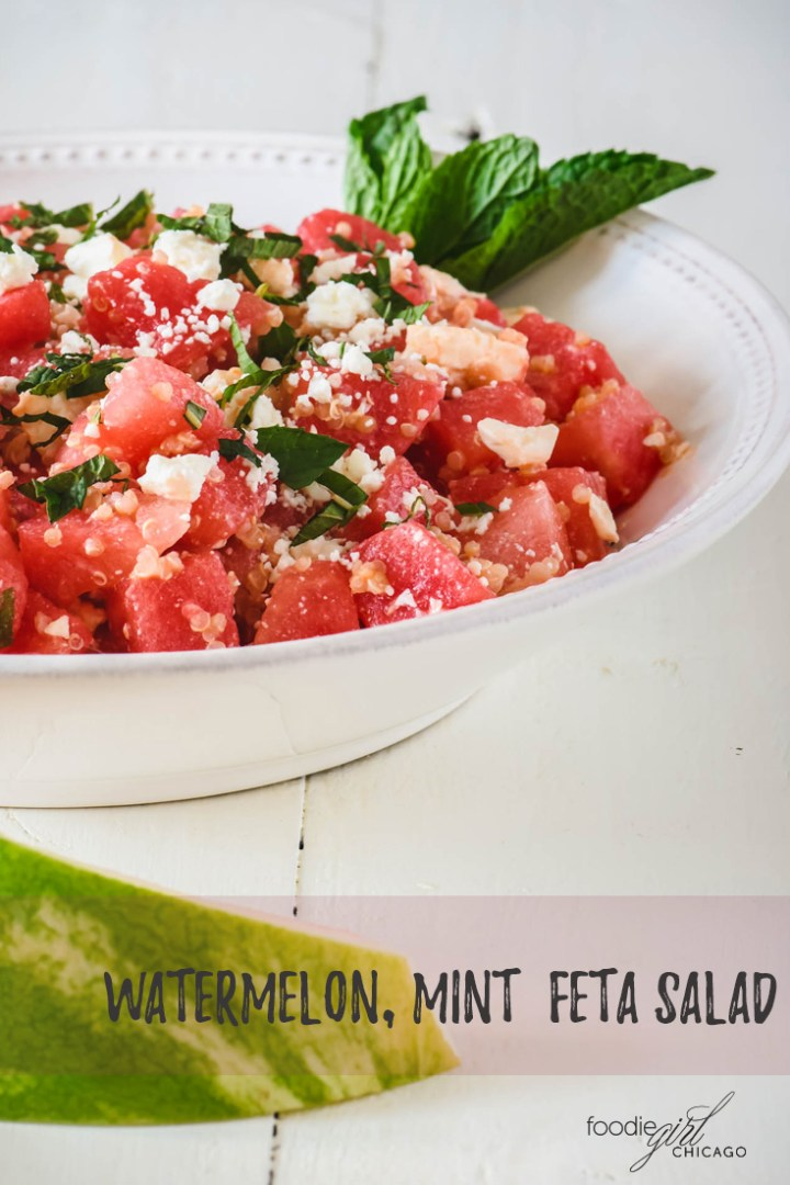 Watermelon salad topped with crumbled feta and mint leaves