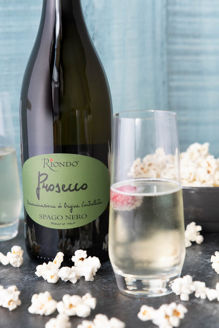 Prosecco cocktail with bottle of Riondo Prosecco