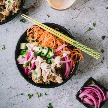 Turkey meatballs, spiralized veggies and sauce in a black matte bowl