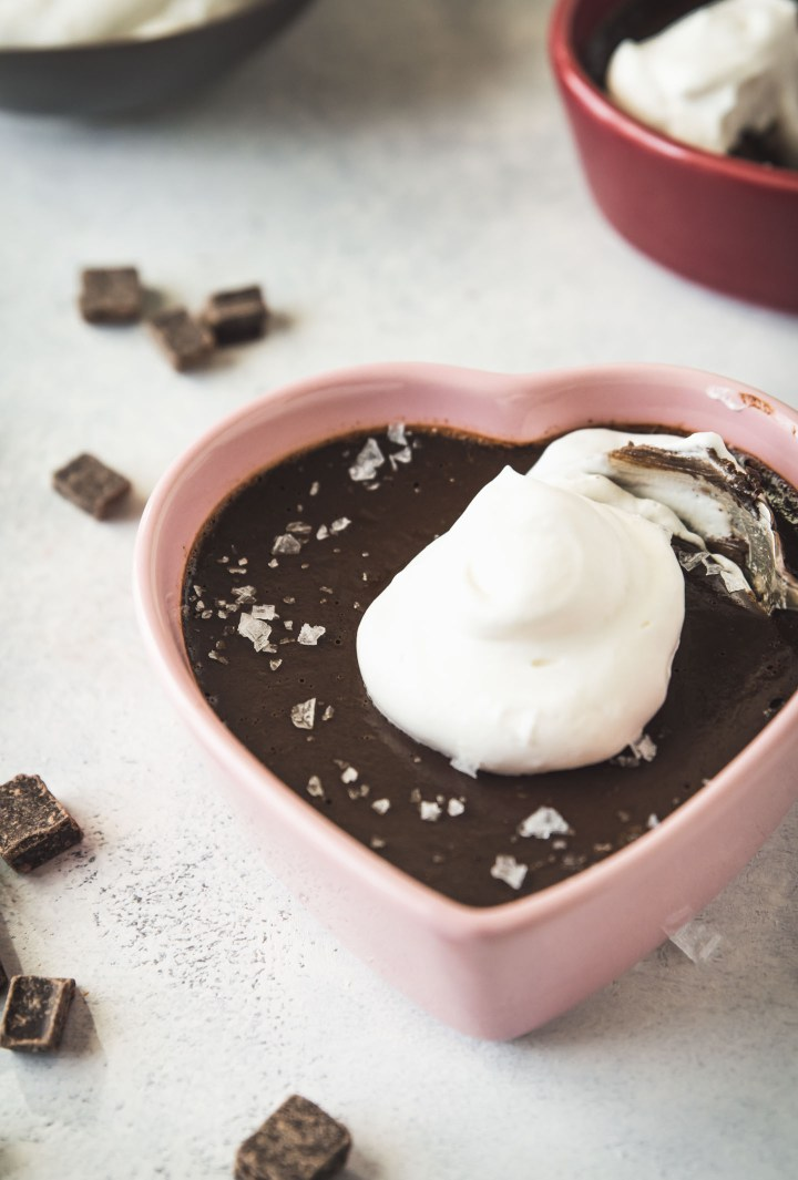 Espresso Chocolate Pot de Creme in a pink heart shaped dish topped with whipped cream