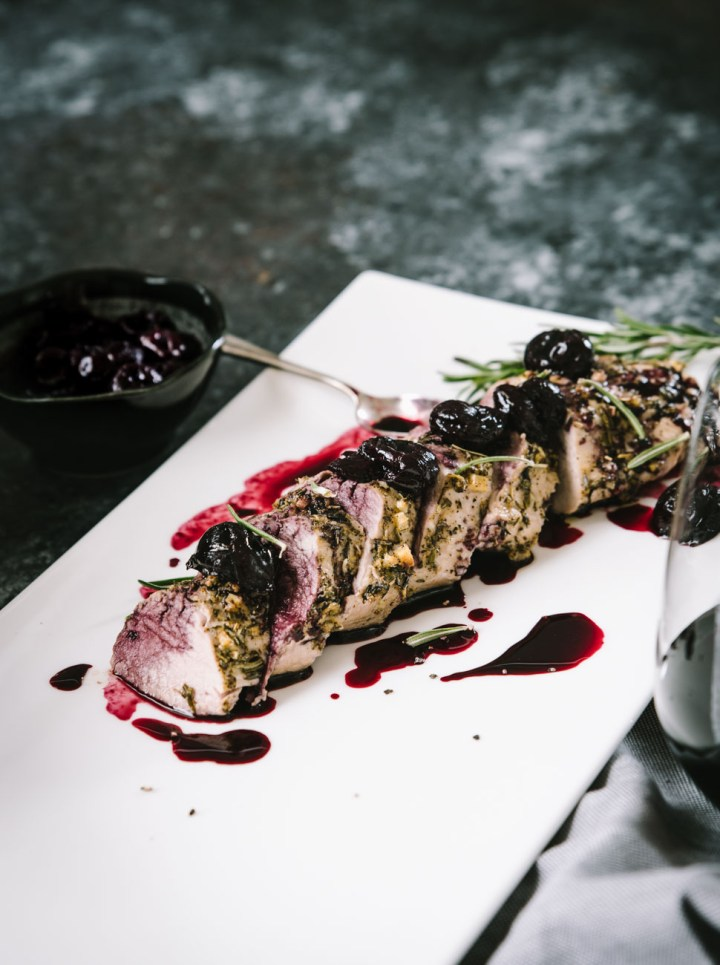 Roasted pork tenderloin topped with a cherry Merlot sauce