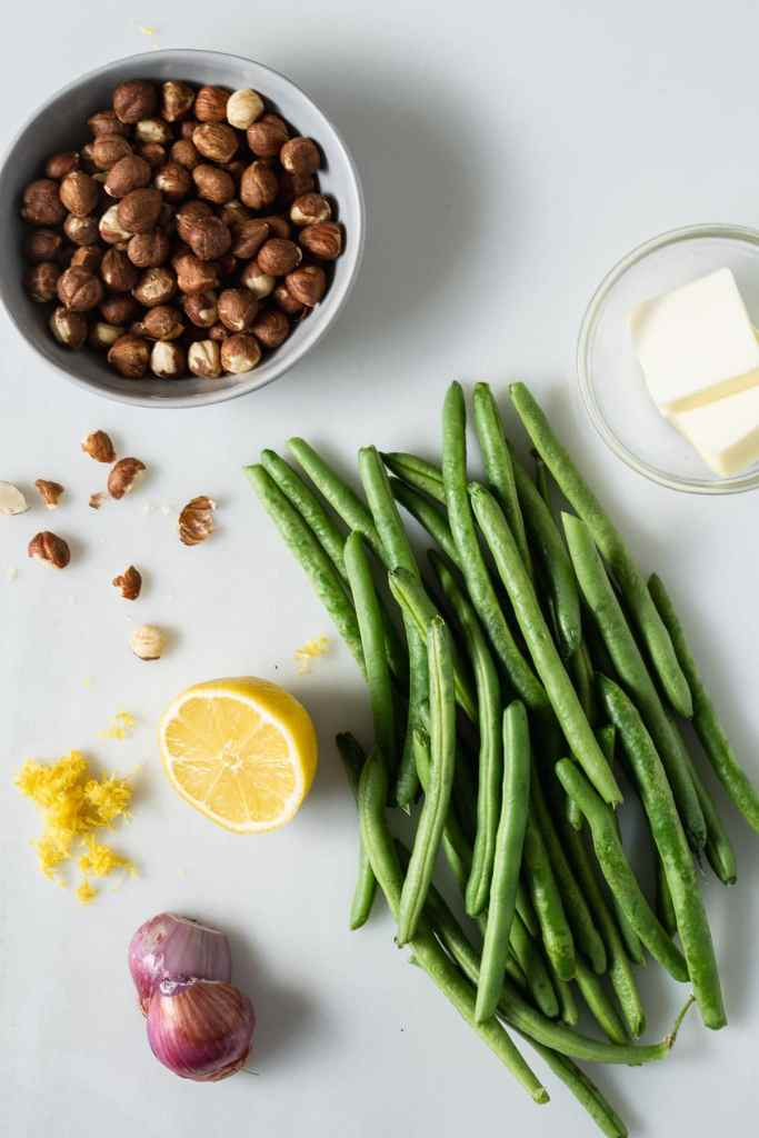 Recipe ingredients - green beans, lemon, hazelnuts, shallot and butter