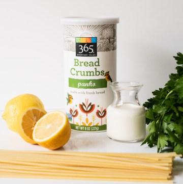 Ingredients for creamy lemon pasta - lemons, bucatini, panko bread crumbs, heavy cream and italian parsley