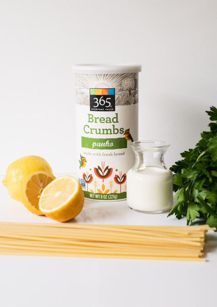 Ingredients for creamy lemon pasta - lemons, bucatini, panko bread crumbs, heavy cream and italian parsley