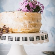 Lemon Lavender layer cake with buttercream frosting topped with purple flowers