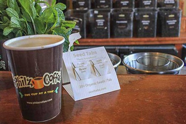 SeedTabs are folded packets of organic seeds sold in coffee shops. Guerrilla gardening.