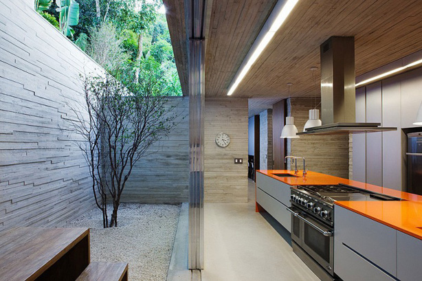 contemporary outdoor kitchen with orange countertop