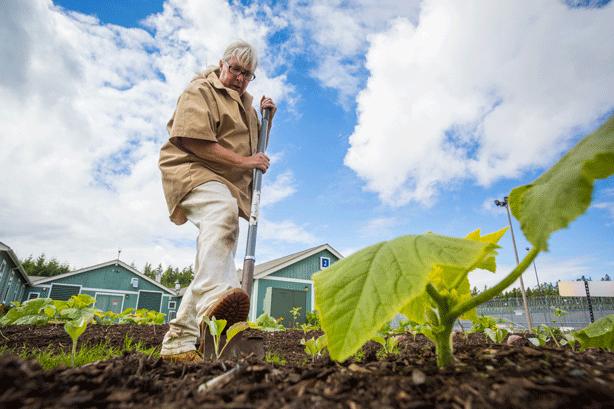 inmate-tilling-soil-in-prison-garden