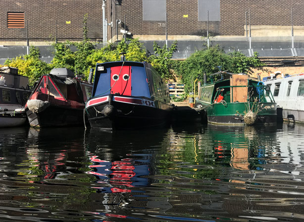 Boats moored on canal in London's Little Venice.