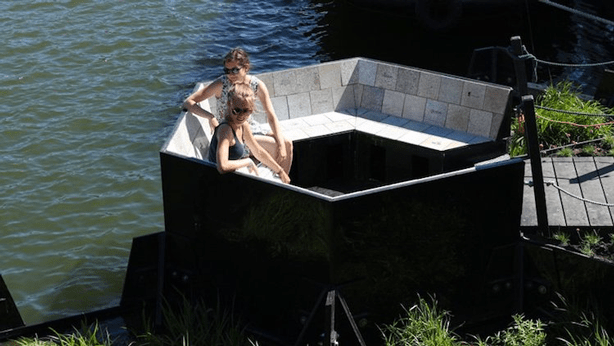 Seating for floating park made entirely of recycled plastic debris.