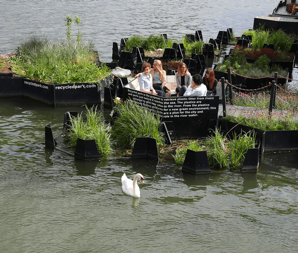 people enjoying floating park in Rotterdam made entirely of recycled plastic