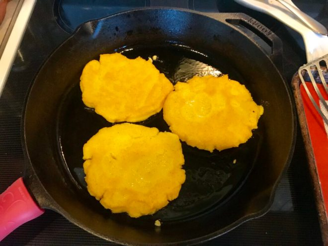 Fry arepas for about 3 minutes a side before baking