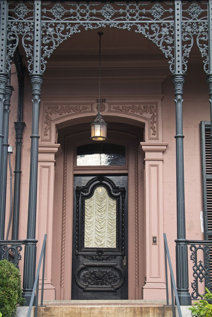 Photo of an ornate door in New Orleans' Garden District