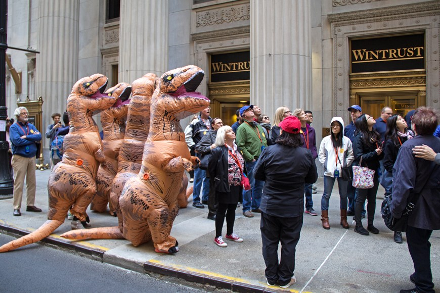 Attendees in dinosaur costumes admire Chicago architecture during Open House Chicago
