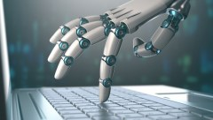 robot hand touching laptop keyboard ai