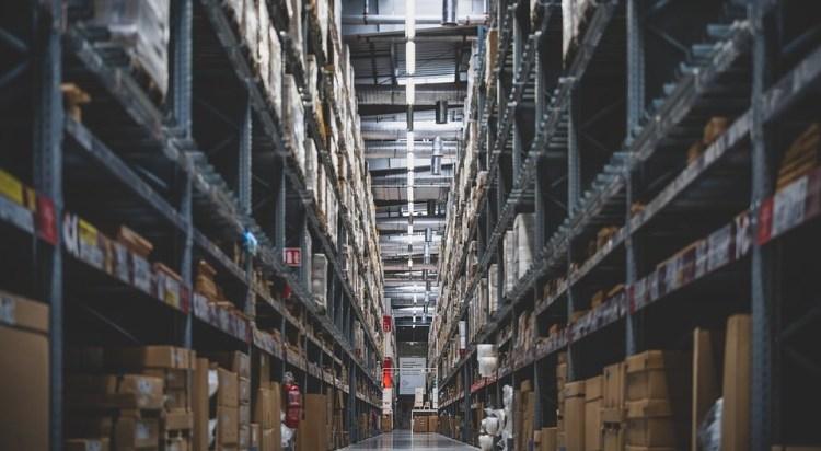 tall warehouse stacks stock