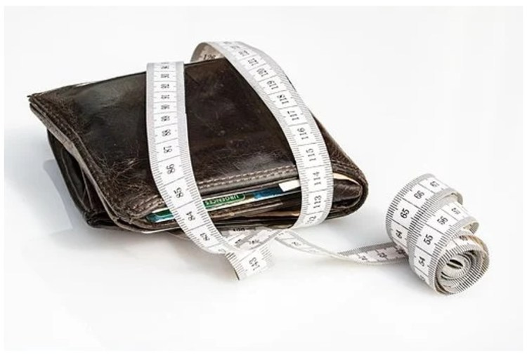 black wallet with measuring tape