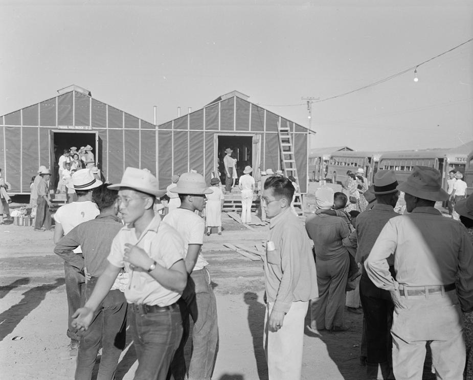 Newly arrived internees explore the Poston Center in Arizona in May 1942, while barracks were still under construction.