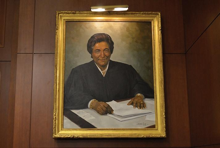 A painting of Judge Constance Baker Motley adorns the Southern District of New York's Jury Assembly Room, which is named after Motley.