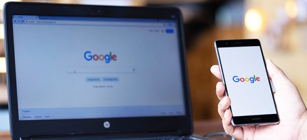 Google logo on laptop and phone