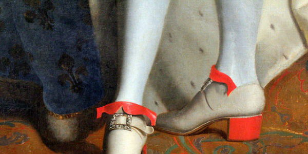 Who wore first high heel shoes? Men or women?