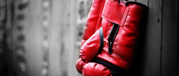 Bare knuckle boxing or Boxing with gloves is safer?