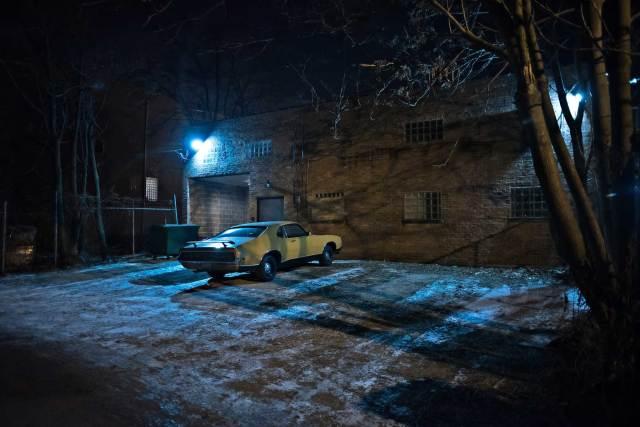 car in dark alley