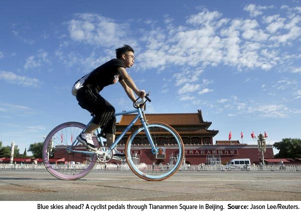 Blue skies ahead? A cyclist pedals through Tiananmen Squar in Beijing