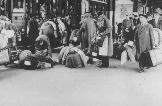 German Jews board a train that will deport them to Theresienstadt. Hanau, Germany, May 30, 1942.  ©Bildarchiv Preussischer Kulturbesitz