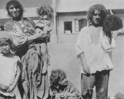 Romani (Gypsy) family near Craiova. Romania, probably 1930s.