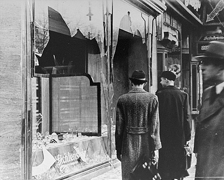 USHMM: Shattered storefront of a Jewish-owned shop destroyed during Kristallnacht (the