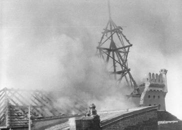 View of the smoldering remains of the roof and cupola of the Annaturmstraße synagogue in Euskirchen on the morning after Kristallnacht.