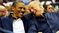 Barack Obama and Joe Biden attend the pre-Olympic exhibition basketball game at the Verizon Center on July 16, 2012 in Washington, DC.