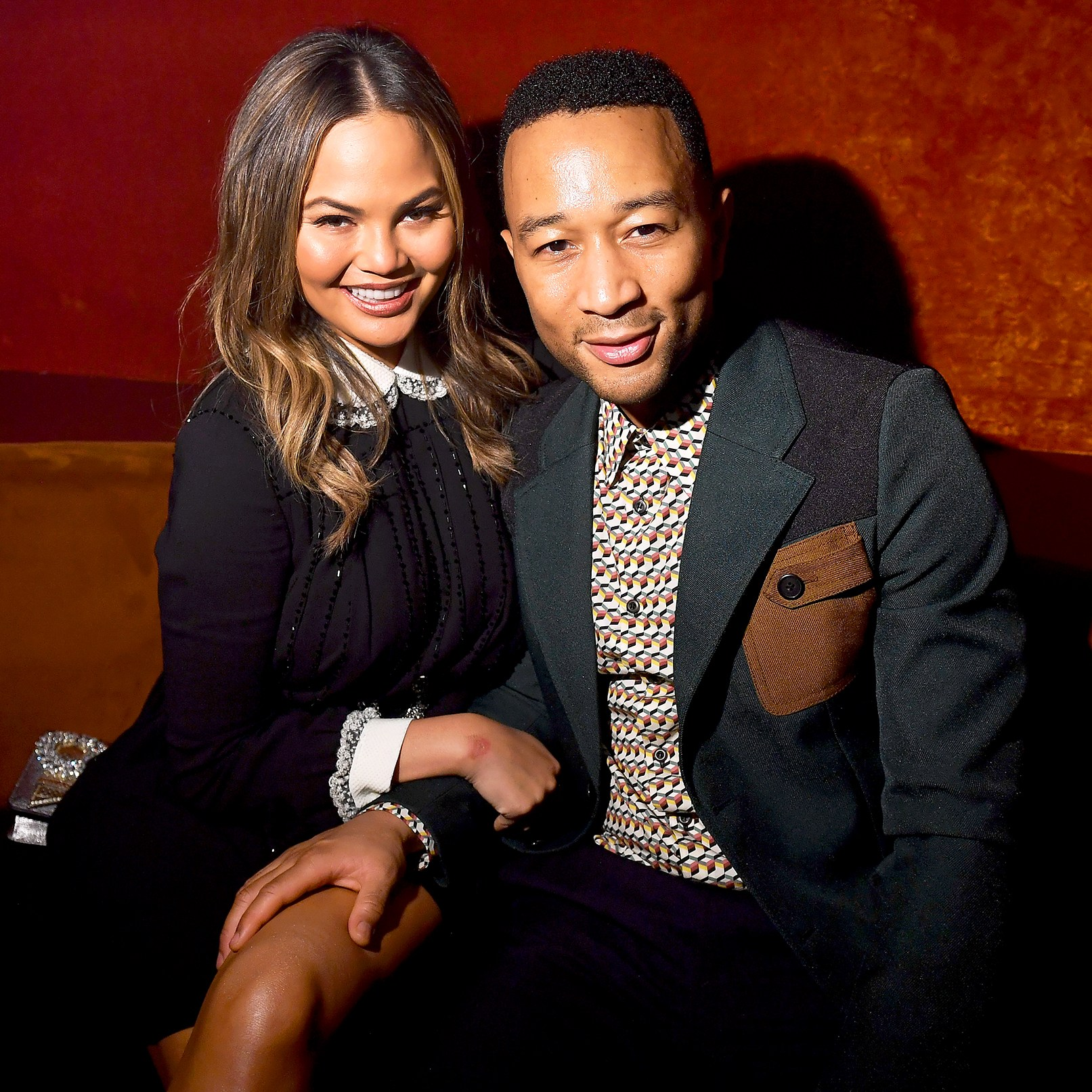 Chrissy Teigen and John Legend attends the Miu Miu aftershow during the Paris Fashion Week at Boum Boum in Paris, France.