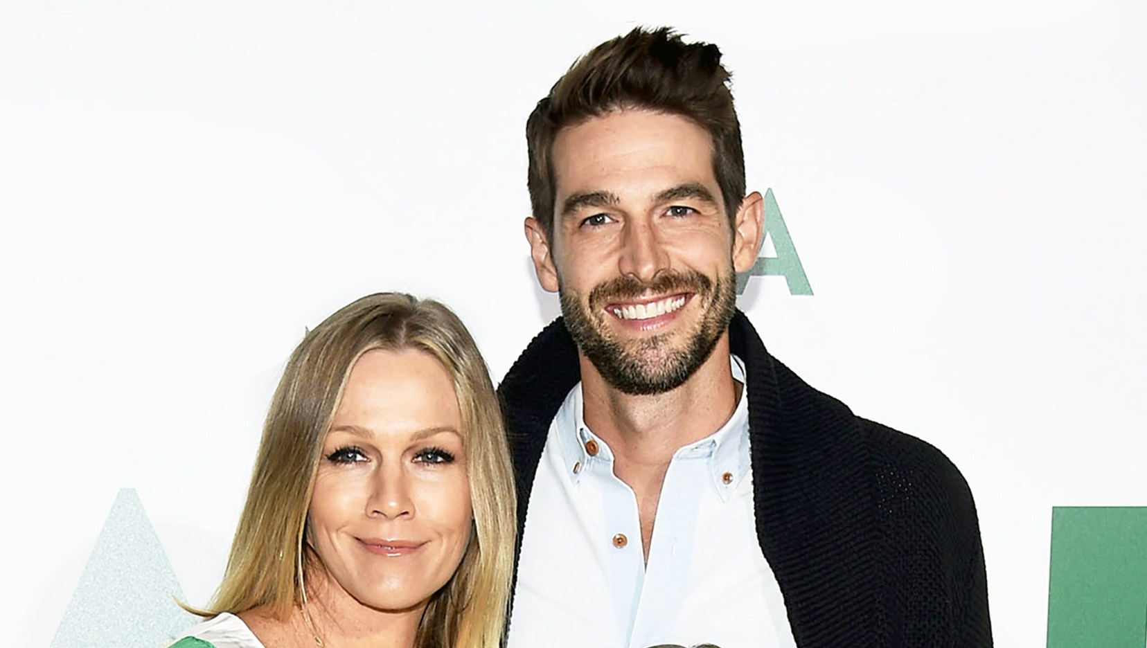 """Jennie Garth, Dave Abrams and Fiona Eve Facinelli arrive at the premiere of National Geographic Documentary Films' """"Jane"""" in Hollywood, California."""