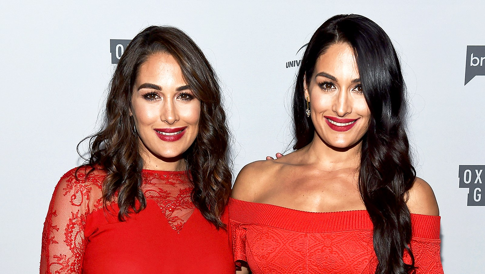 Brie Bella and Nikki Bella arrive at NBCUniversal's Press Junket at Beauty & Essex on November 13, 2017 in Los Angeles, California.