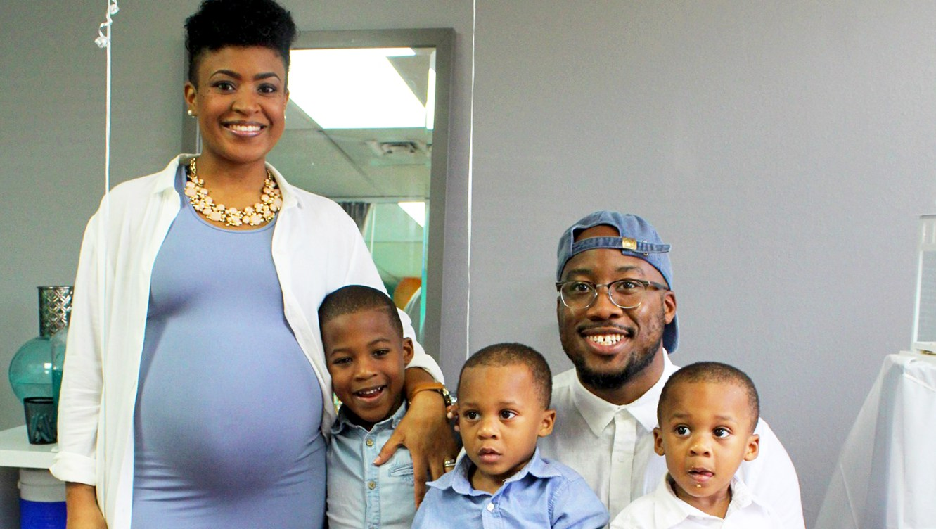 Nia and Robert Tolbert with their sons Shai and twins Alexander and Riley