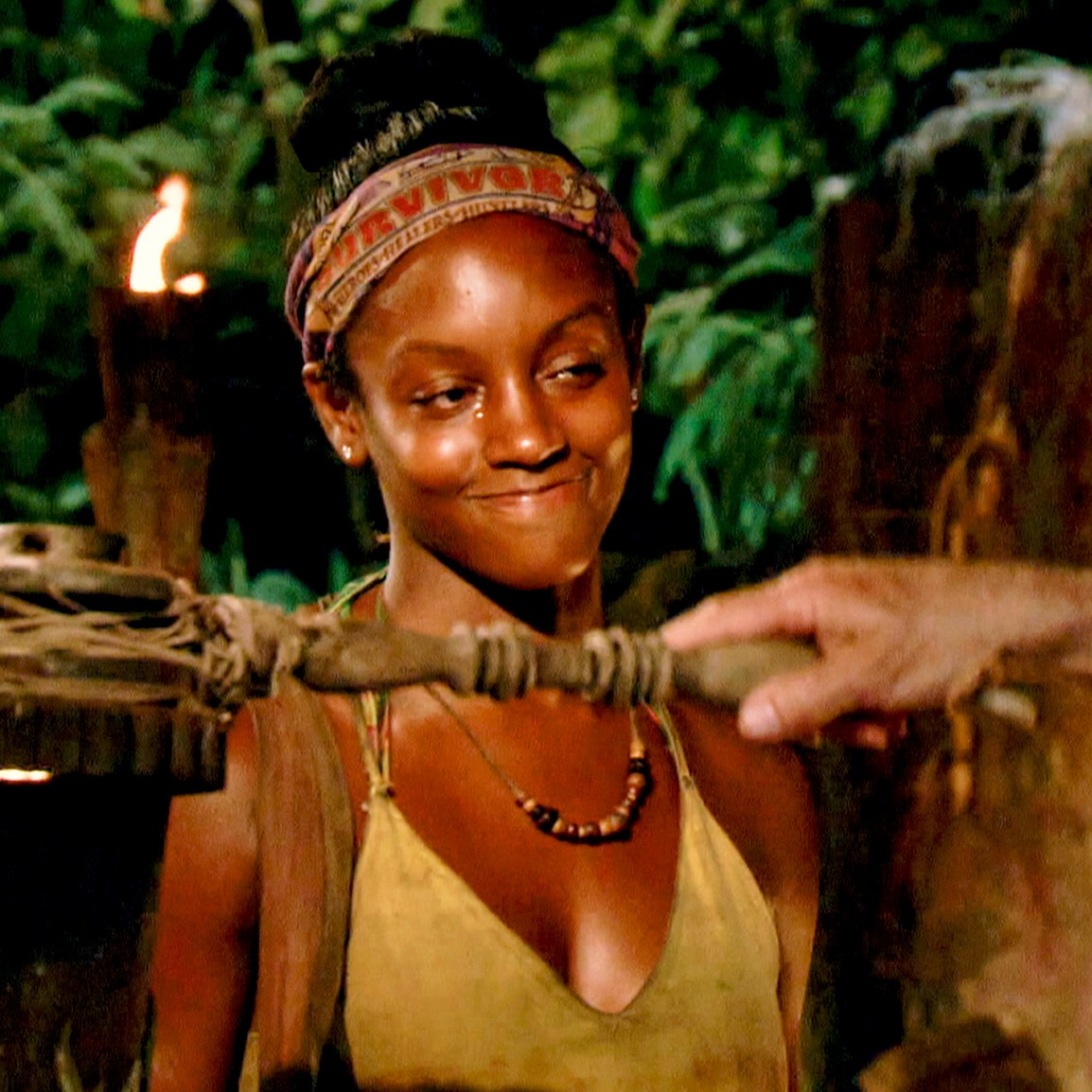 Jeff Probst extinguishes Desi Williams torch at Tribal Council on the eighth episode of Survivor themed Heroes vs. Healers vs. Hustlers
