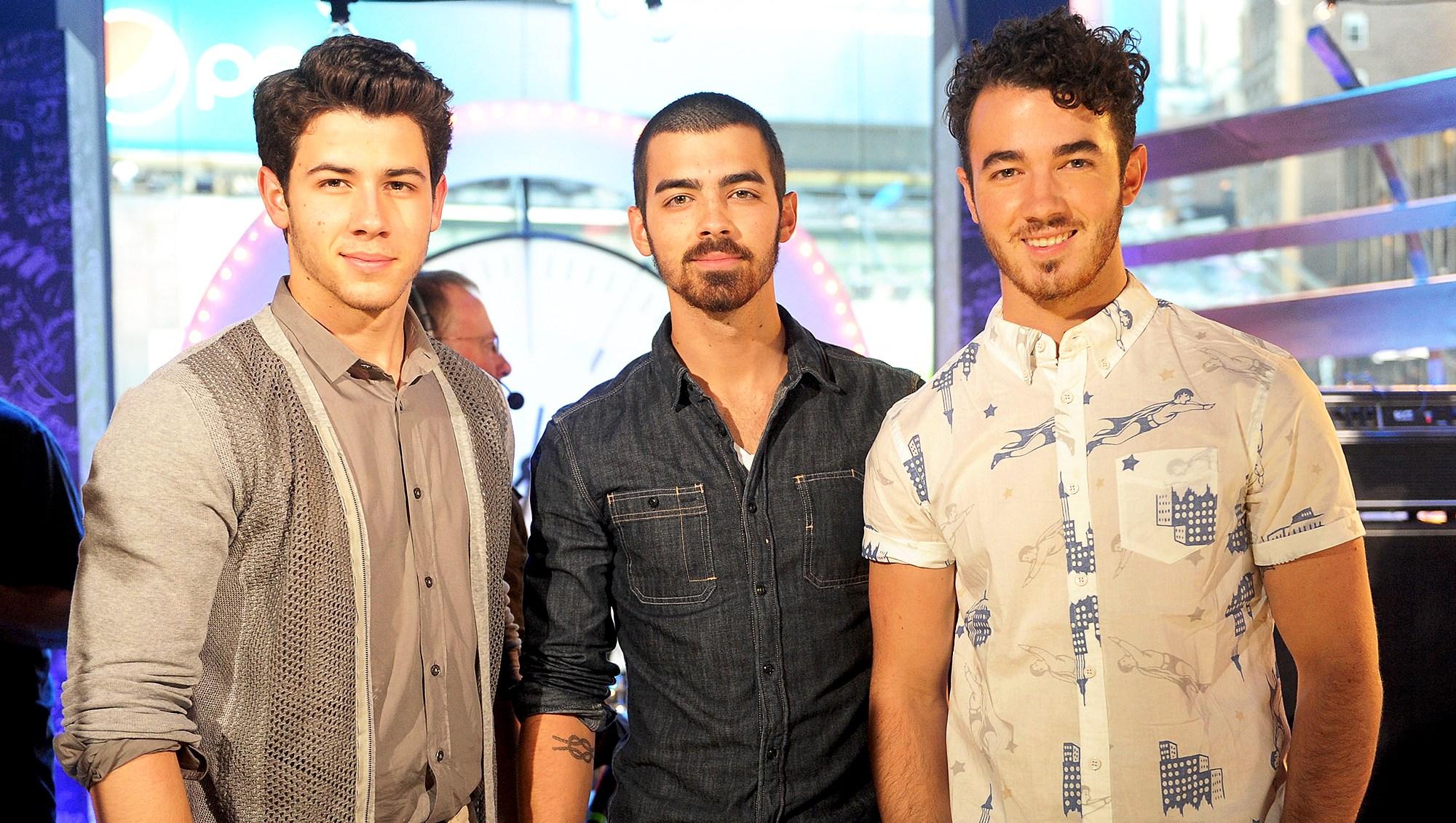 Nick Jonas, Joe Jonas and Kevin Jonas perform during the MTV, VH1, CMT & LOGO 2013 O Music Awards in New York City.