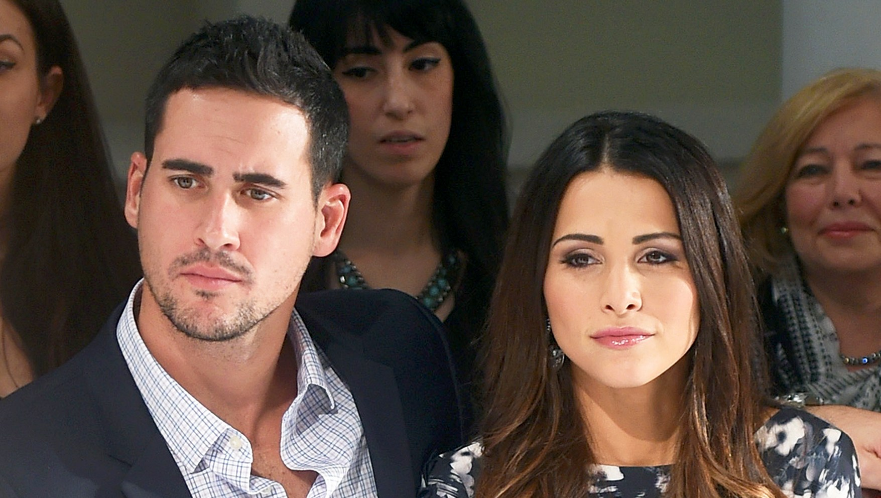 Josh Murray and Andi Dorfman attend front row at The Mark Zunino For Kleinfeld 2015 Runway Show at Kleinfeld in New York City.