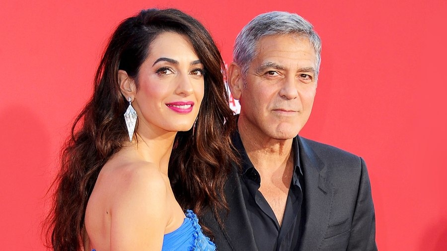 """George Clooney and wife Amal arrive at the Los Angeles Premiere """"Suburbicon"""" at Regency Village Theatre on October 22, 2017 in Westwood, California."""
