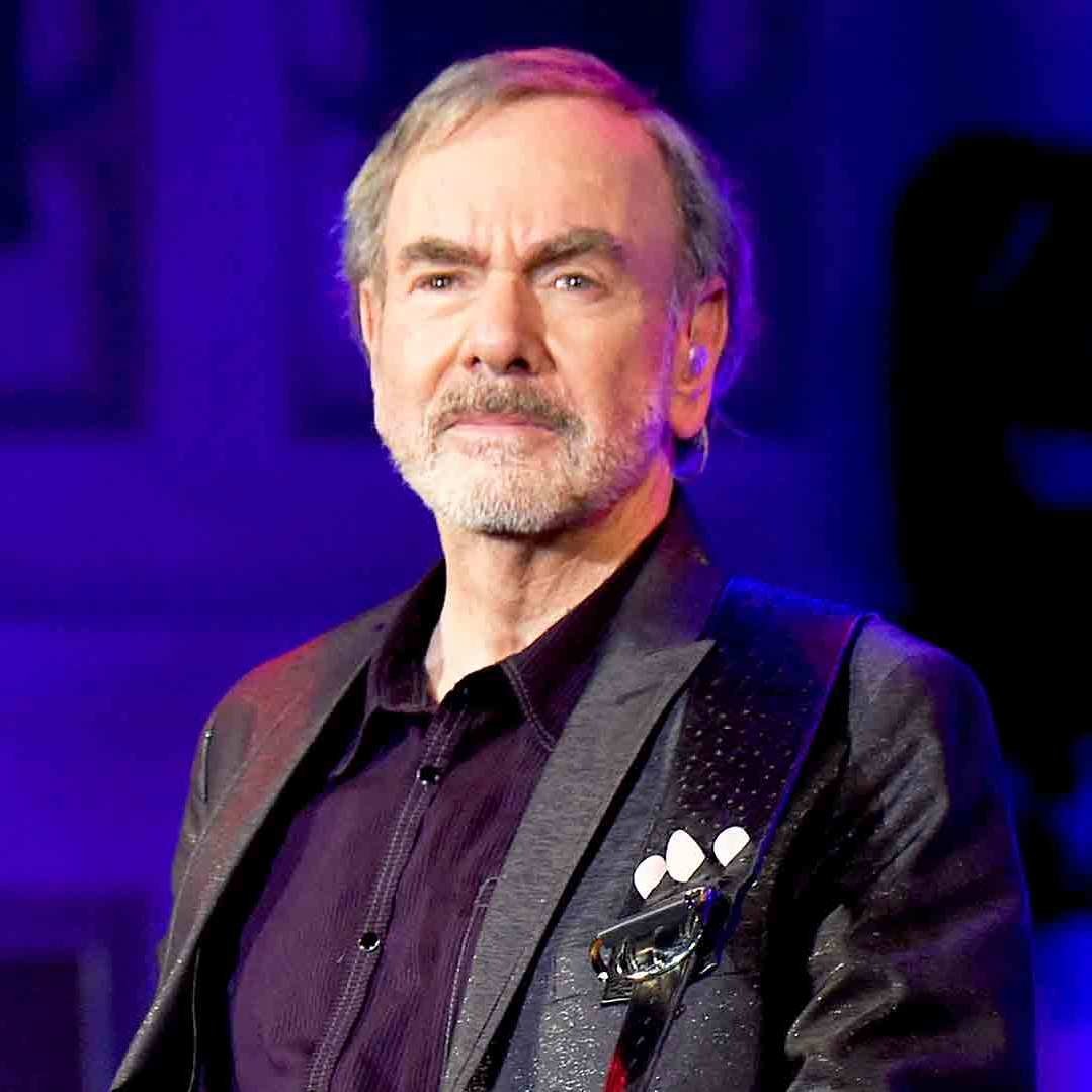Neil Diamond performs onstage at Erasmus Hall High School in Brooklyn, New York.